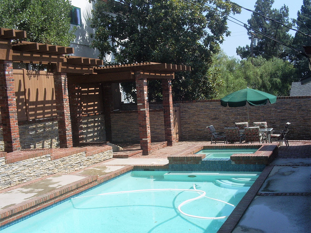 Ed's Landscaping pool pergola and cultured stone walls