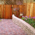 Wood fence pavingstone walk wood fence and block wall garden bed
